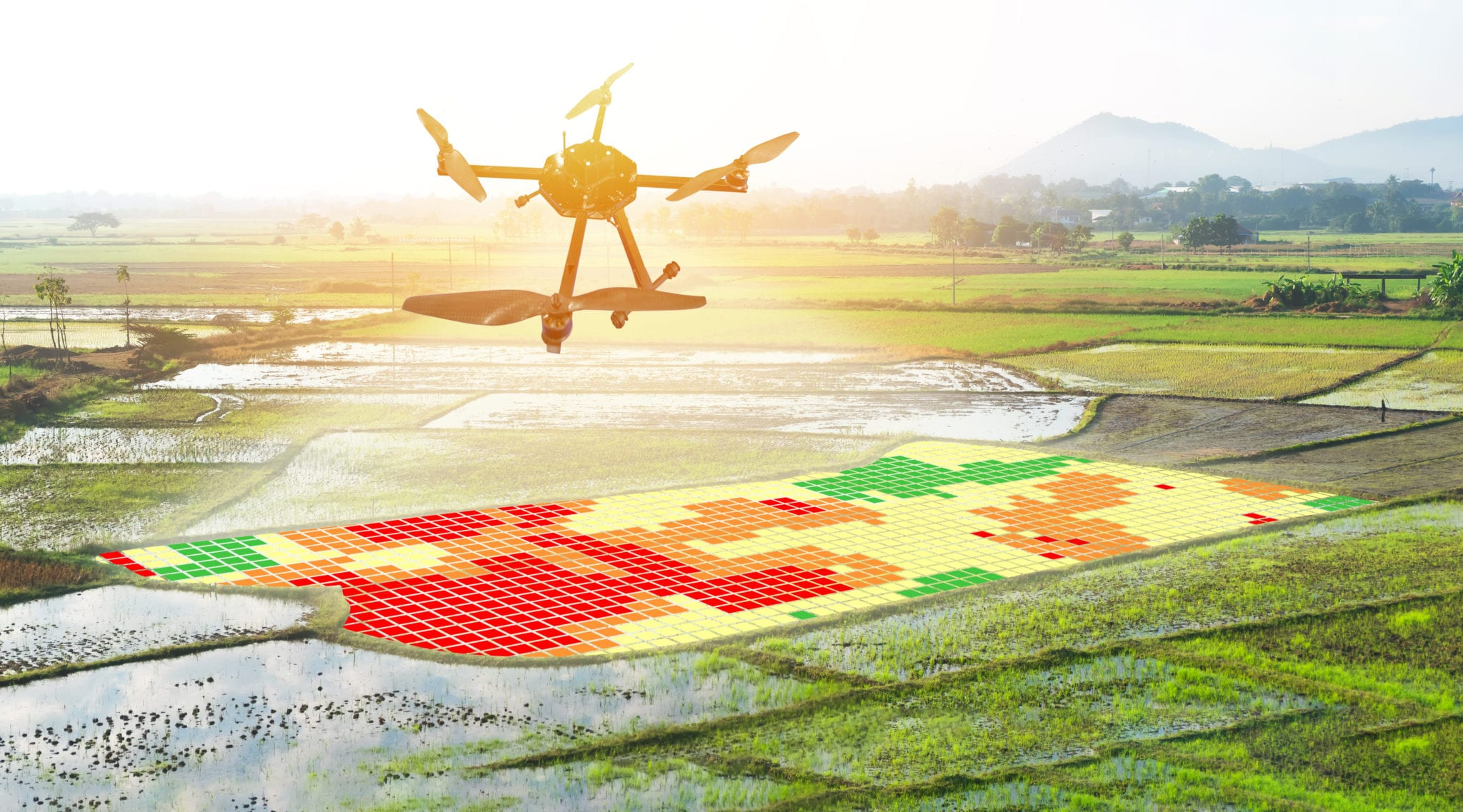 A drone helicopter flying over a digitized farm field representing data collection